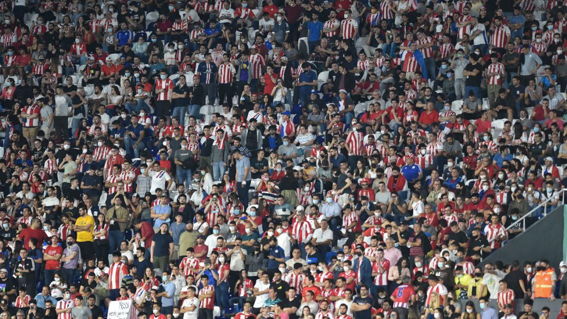 Paraguayan fans are seen on the stands before the South American qualification football match for the FIFA World Cup Qatar 2022 against Argentina at the Defensores del Chaco stadium in Asunción on October 7, 2021.