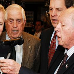Buddy McCluskey, together with other Americans, leads the Club in a rendition of the hymn 'America the Beautiful.' Buddy's name became almost synonymous with that of the American Club. Photo from Thanksgiving Lunch 2014.