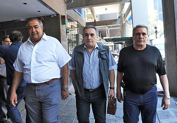 triunvirato. Esta semana asomaron internas entre los tres líderes de la central sindical.