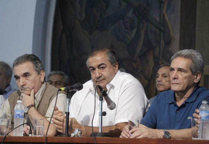 Los dirigentes Carlos Acuña, Juan Carlos Schmid y Héctor Daer.