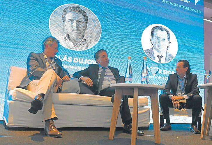 TIJERAs. Cabrera, Dujovne y Dante Sica, en el seminario de la consultora Abeceb esta semana.