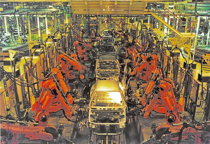 Robotizacion. Una revolución que modificó la producción de bienes y servicios.