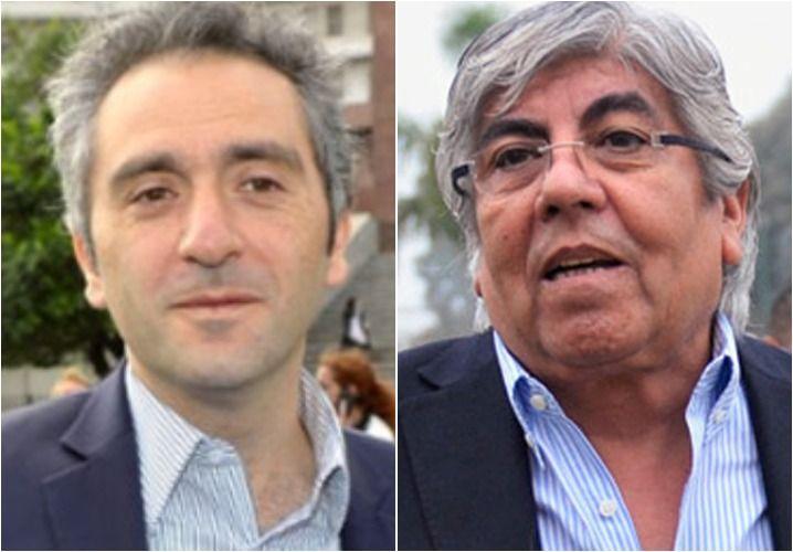 Izquierda. Andrés Larroque. Derecha. Hugo Moyano.