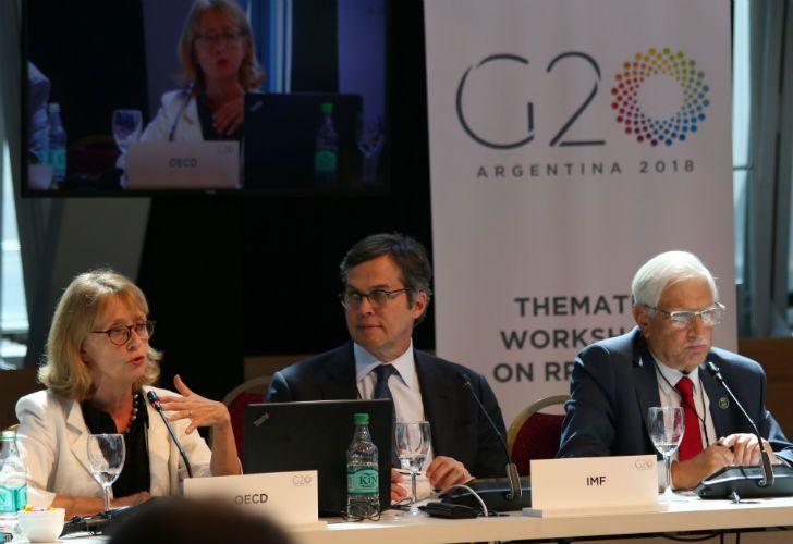 Durand, Ducharme y Todesca en la reunión de estadística, en el CCK