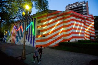 The usually impeccably white Palais de Glace, in bright-coloured stripes and wrapped in neon lights painted by French artist Bertrand Ivanoff as part of the recent opening of the South American biennale, Bienalsur in Buenos Aires, Argentina.