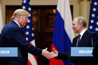 Alongside Putin, Trump questions US intelligence on Russia election meddling