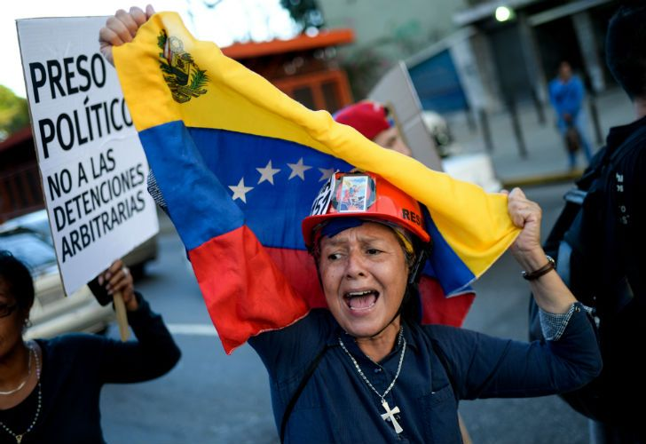 Venezuelan opposition activists carry out a rally in Caracas this week.