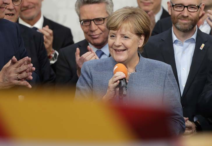 Chancellor Angela Merkel won a fourth term Sunday night, but now faces the tricky prospect of forming a coalition with two disparate new partners after voters weakened her conservatives and a far right, nationalist, anti-migrant party surged into Parliament.