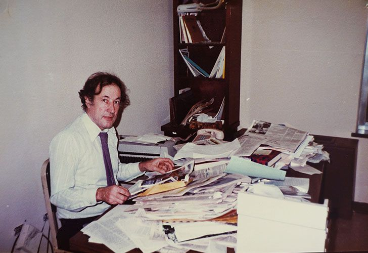 Robert Cox sits at his desk in his office at the Buenos Aires Herald, in the 1970s.