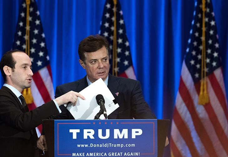 This file photo taken on June 21, 2016 shows former Trump campaign chairman Paul Manafort checking the podium before Donald Trump speaks during an event at the Trump SoHo Hotel, in New York City.