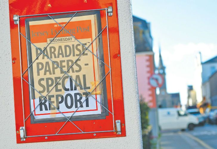 A billboard for the Jersey Evening Post newspaper advertises a special news report in St Helier, Jersey. The channel island has come under the spotlight with the publication of the Paradise Papers, highlighting its status as a tax destination for multinational companies.