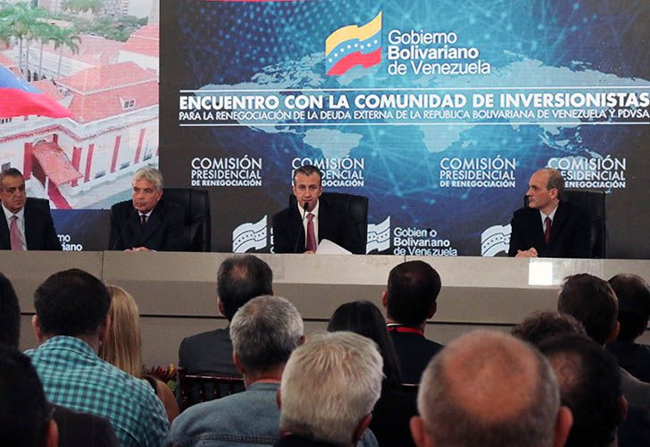 Venezuela's Vice-President Tareck El Aissami (centre) speaks during a meeting with creditors and investors in Caracas on Monday.