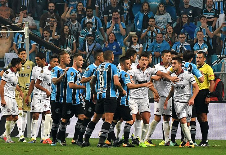 Gremio and Lanús players argue at the end of their 2017 Copa Libertadores first leg final match at Arena Gremio stadium, in Porto Alegre, Brazil. Gremio won 1-0.