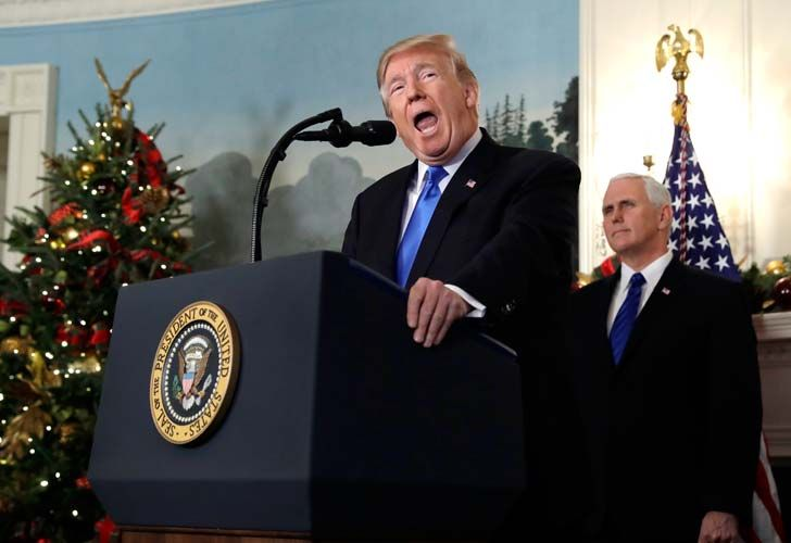 US President Donald Trump speaks in the Diplomatic Reception Room of the White House on Wednesday. Trump recognized Jerusalem as Israel's capital despite intense Arab, Muslim and European opposition to a move that would upend decades of US policy and risk potentially violent protests. Vice-President Mike Pence listens on behind him.