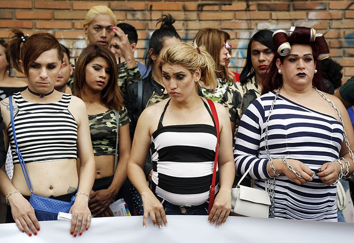 Members of a gay organisation, Panambi, meaning butterfly in Guaraní, protest the killing of transvestite prostitutes and demand equal rights for gays during the annual LGBQT parade in Asunción, Paraguay.