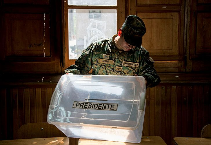 A Chilean soldier checks a ballot box at a polling station, at the Amunategui highschool in Santiago on December 15, 2017 during preparations ahead of the upcoming December 17, presidential election.