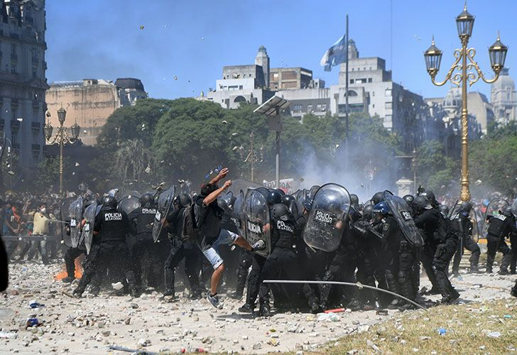 Riot police clash with demonstrators protesting against proposed pension reforms outside the National Congress.
