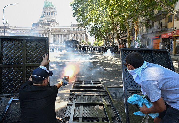 As Buenos Aires' downtown became a battle ground with clashes between police and rock-weilding protesters, 162 people were wounded and 68 were arrested.