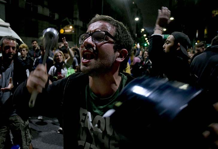 Opposing voices turned to pot banging in Buenos Aires on Monday and Tuesday night, following the passing of a controversial pension reform bill that saw police and protesters clash violently near Argentina's Congress.