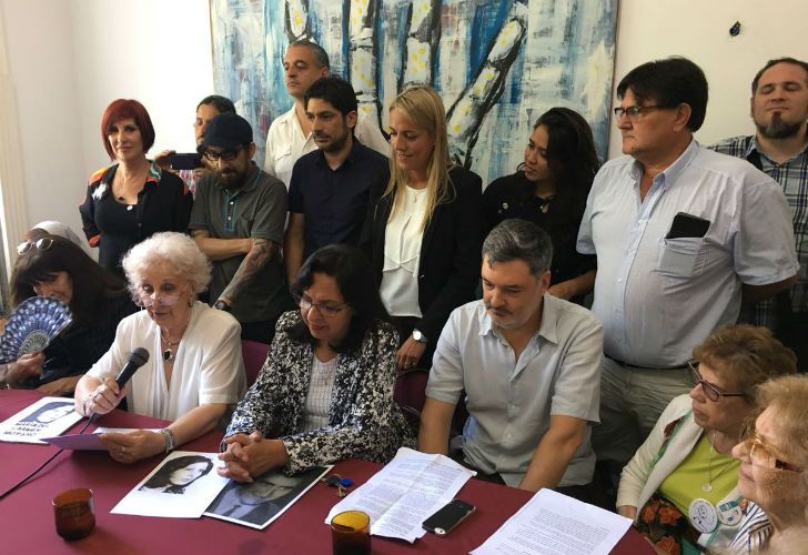President of Grandmothers of Plaza de Mayo Estela Carlotto with relatives of the 127th recovered grandchild.