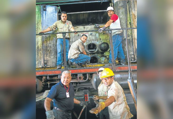 Workers repair a locomotive at Ferrominera Orinoco, in Ciudad Guayana, Bolívar state.