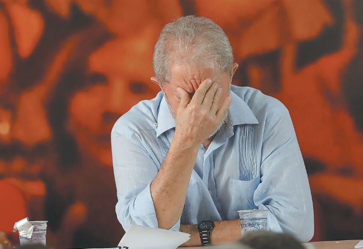 Former Brazil president Luiz Inácio Lula da Silva rubs his forehead during a meeting with the executive members of the Workers' Party (PT), in São Paulo on Thursday.