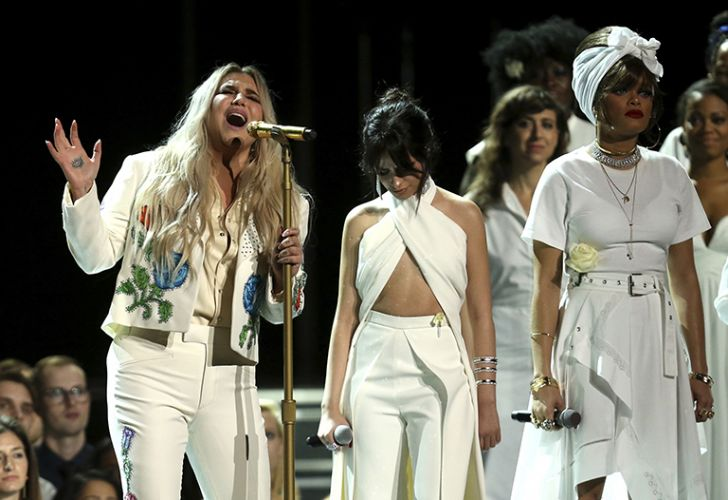 Kesha (left) performs