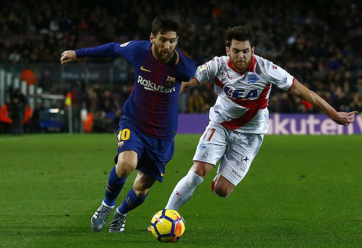 Lionel Messi, left, duels for the ball against Alavés player Ibai Gomez in a league match last weekend in which Messi scored the winning goal.