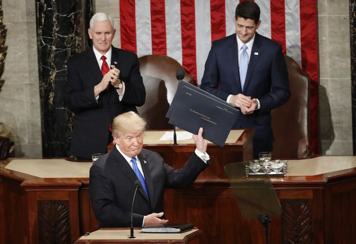United States President Donald Trump holds up copies of his speech before the State of the Union address to a joint session of Congress on Capitol Hill in Washington on Tuesday night.