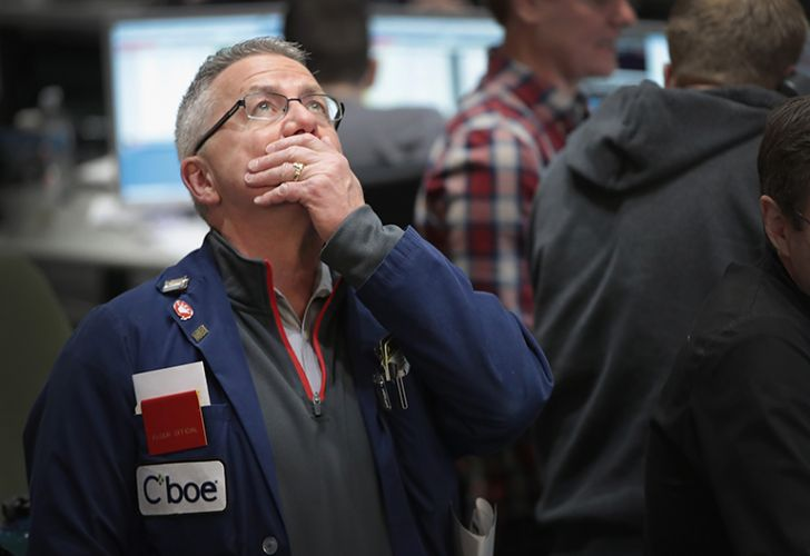 A trader watches prices in the VIX pit at the Cboe Global Markets, Inc. exchange (previously referred to as CBOE Holdings, Inc.) in Chicago, Illinois.