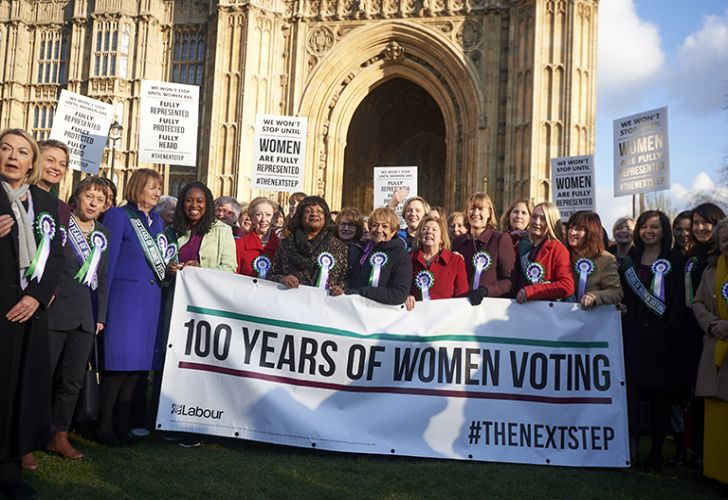 Female MPs from the opposition Labour Party pose for a photograph outside the British Houses of Parliament to mark the centenary of women's suffrage in London on February 6, 2018 Prime Minister Theresa May led tributes to the