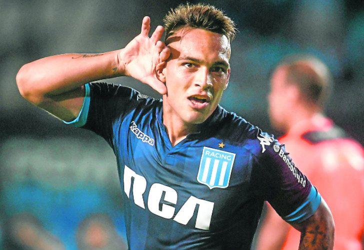Lautaro Martínez celebrates scoring for Racing Club.