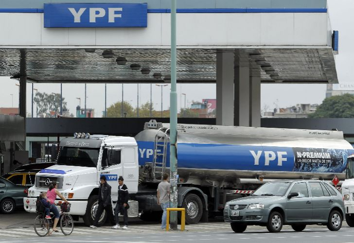 An YPF truck delivers fuel to a gas station.