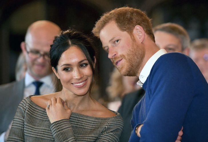 Great Britain's Prince Harry talks with his fiancé, American actress Meghan Markle while watching a dance performance by Jukebox Collective in the banqueting hall during a visit to Cardiff Castle, Wales in January.