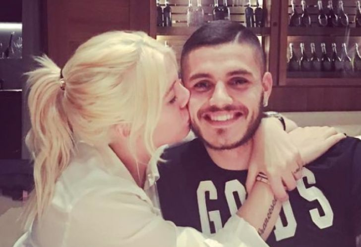 Inter Milan forward Mauro Icardi is kissed by his wife and agent, Wanda Nara.