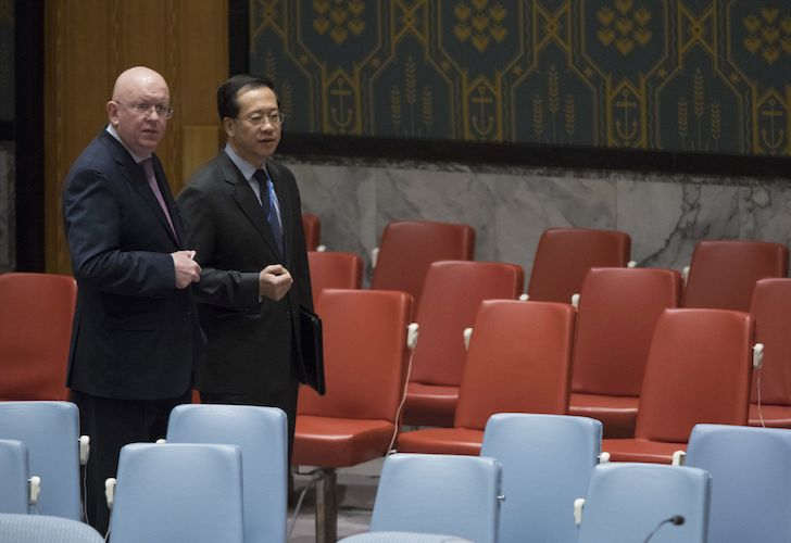 Russia's United Nations ambassador Vassily Nebenzia, left, and China's UN ambassador Ma Zhaoxu talk on Friday before a UN Security Council meeting.