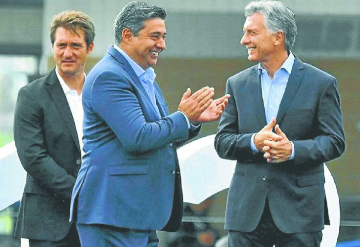 Boca coach Guillermo Barros Schelotto (left), club President Daniel Angelici (centre) and President Mauricio Macri.