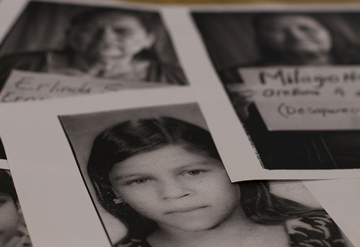 This February 16, 2018 photo, shows an image of Ana Julia Mejia who disappeared during the El Salvador civil war, along portraits of Salvadoran women who lost their siblings during the civil war, in San Salvador, El Salvador.
