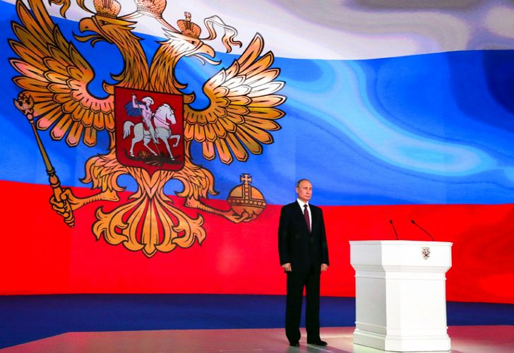 Russian President Vladimir Putin stands after giving his annual state-of-the-nation address in Manezh in Moscow.