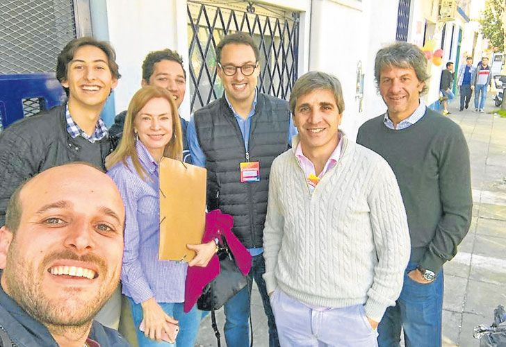 Leandro Cuccioli (third from the right) is seen with Finance Minister Luis Caputo (second from the right) during door-knocking for the 2017 mid-term campaign.