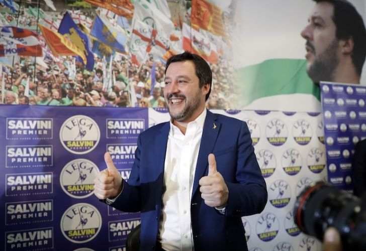 Matteo Salvini, leader of Italy's right-wing, anti-immigrant and euro-skeptic party Lega, gives the thumbs up at a press conference in Milan on Monday.