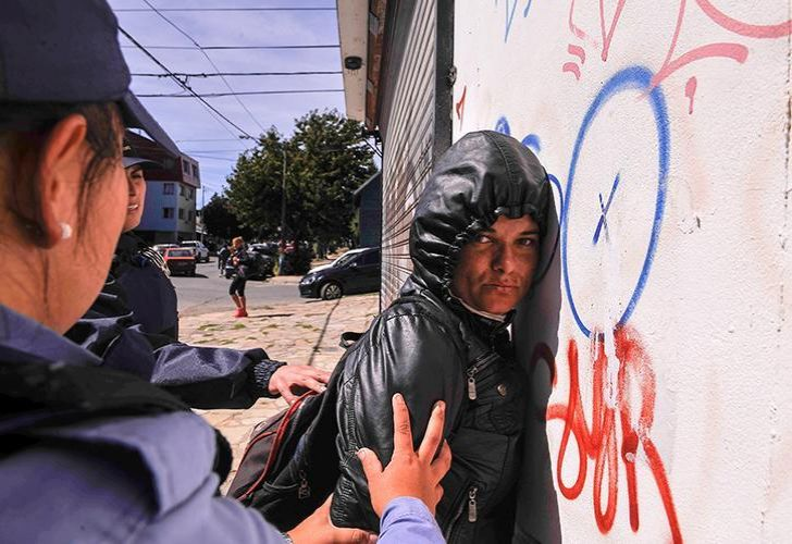 Police detain a protester as tensions heightened in the city of Bariloche over the extradition of Facundo Jones Huala.