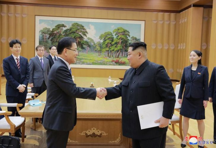 North Korean leader Kim Jong Un, front right, shakes hands with South Korean National Security Director Chung Eui-yong after Chung gives Kim a letter from South Korean President Moon Jae-in, in Pyongyang on Monday. Image provided by North Korean state media.