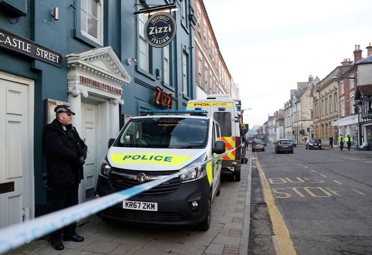 A policeman stands outside the Zizzi restaurant in Salisbury, close where former Russian double agent Sergei Skripal was found critically ill. Britain's counterterrorism police took over an investigation Tuesday into the mysterious collapse of a former spy and his daughter, now fighting for their lives. Sergei Skripal and his daughter are in a critical condition after collapsing in the English city of Salisbury on Sunday.