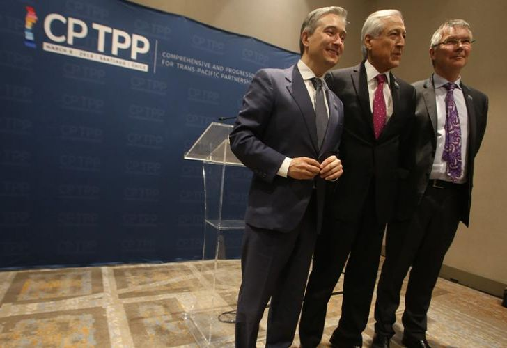 Chile's Foreign Minister Heraldo Muñoz (centre), New Zealand's Trade and Export Growth Minister David Parker (right) and Canada's Trade Minister Francois-Philippe Champagne pose for pictures before signing the rebranded 11-nation Pacific trade pact Comprehensive and Progressive Agreement for Trans-Pacific Partnership (CPTPP) in Santiago, on March 8.