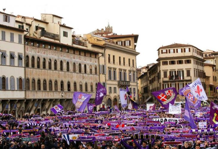 Fiorentina fans wait outside the church during Thursday's funeral ceremony for Italian player Davide Astori in Florence, Italy.
