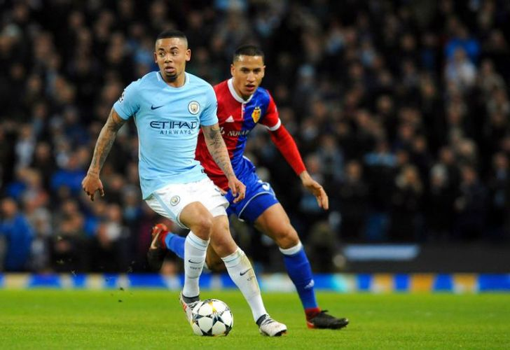 Manchester City forward Gabriel Jesus, left, dribbles during City's Champions League Round of 16 second leg match against FC Basel in Manchester, England on Wednesday.