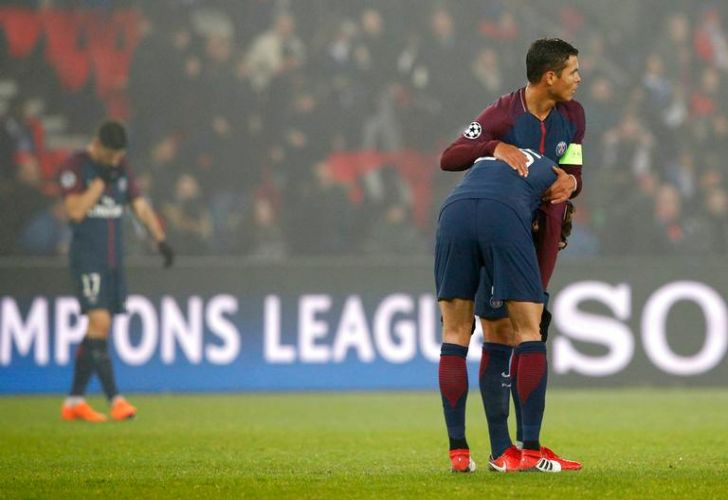 PSG captain Thiago Silva, right, hugs Adrien Rabiot after the Champions League Round of 16 second leg against Real Madrid in Paris on Tuesday.