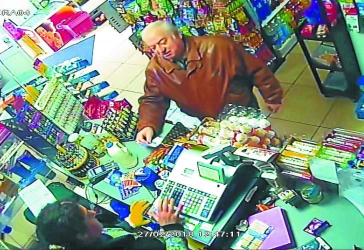 In this February 27, 2018 grab taken from CCTV video, former spy Sergei Skripal shops at a store in Salisbury, England.