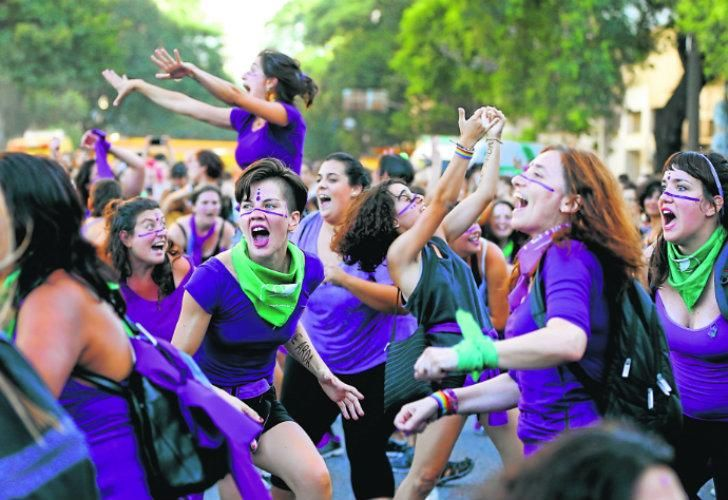 Demonstrators sing and dance before the National Congress demanding equality, an end to gender-based violence, and to press for the legislation of abortion.